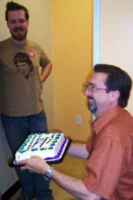 Mike Chapman gets a joking Fail Whale birthday cake. Dave Neff looks on. (Scarborough photo)